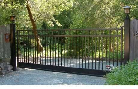 Aluminum fence attached to wood fencing, Fence Scapes, WNC