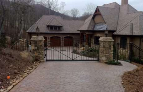 gate operator for house with stone columns and brick driveway