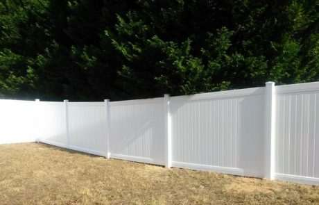 PVC and vinyl fencing bordering trees