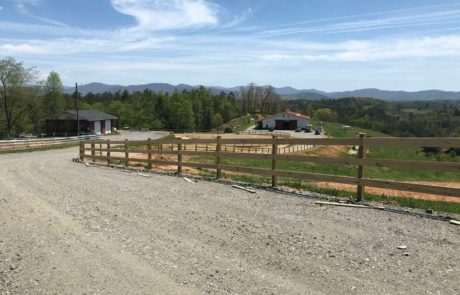 farm and livestock fencing along driveway to barn