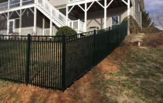 Iron fencing with right angle turn in backyard