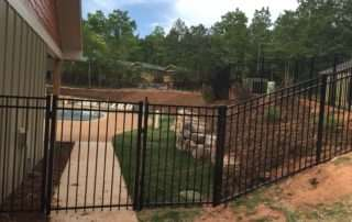 aluminum fence with gate over sidewalk to pool area