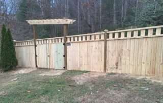 Wooden fence with arbor gate