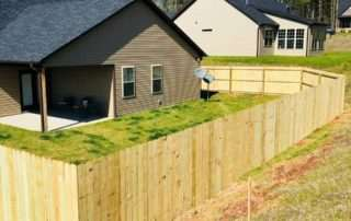 wooden fence encompassing house