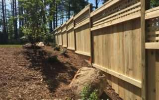 Tiered wooden fence in backyard