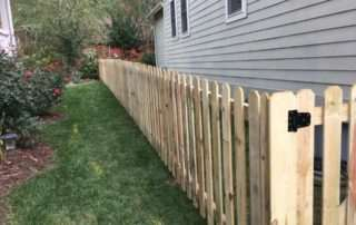 Picket fence on side of house