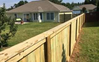 Backyard wooden fence around small patio