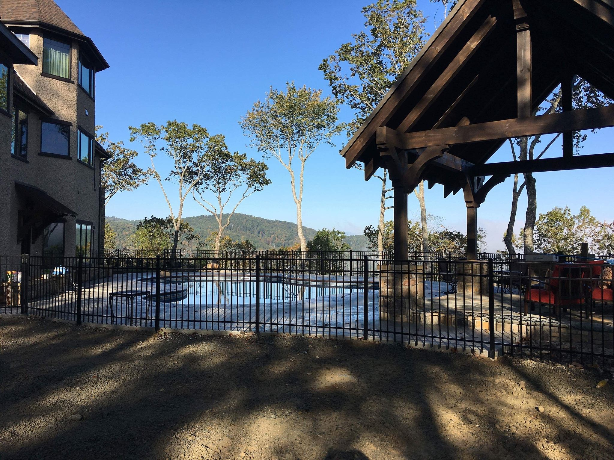 Aluminum and iron fencing around residential pool