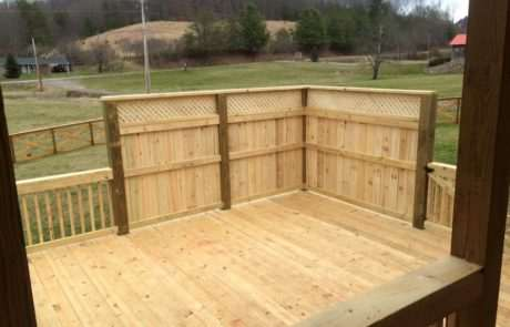 wooden backyard deck with private corner wall