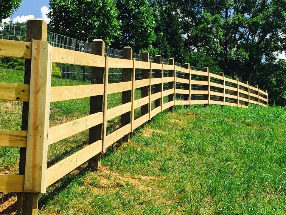 Farm & Livestock wooden fence on grassy slope - Fence Scapes, Asheville, NC